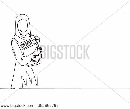 Single Continuous Line Drawing Of Young Female Muslim Businesswoman Carrying Annual Report Books To