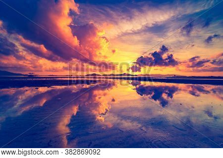 Thailand ocean sunrise silhouette aerial: mountain island on sea bay waterfront reflection romantic sky. Asian picturesque sun rise with boat on water. Epic nobody nature seascape in warm soft tones