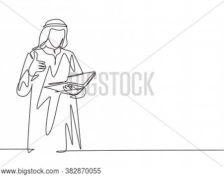 One Single Line Drawing Of Young Male Muslim Businessman Giving Thumbs Up Getures While Read A Book.