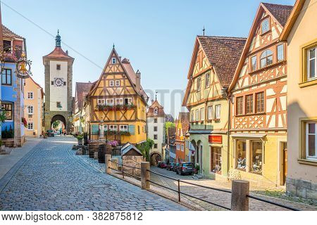 Rothenburg Ob Der Tauber,germany - August 09,2020 - Siebersturm And Kobolzeller Towers In The Street