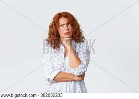 Thoughtful And Indecisive Female Entrepreneur, Redhead Woman In Shirt, Looking Upper Left Corner And