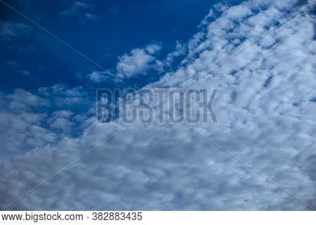Landscape At The Sky With Streaks Of White Clouds.