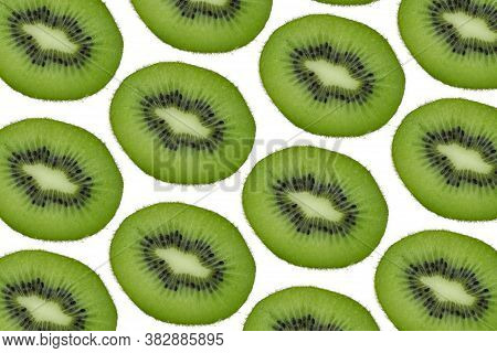 Seamless Pattern Of Kiwi, Slices Of Kiwi On A White Background. From Top To Bottom. Background Of Pa