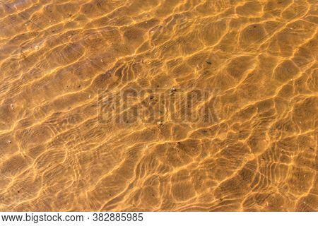 Texture Of Ripple Sea Water With Sand Bottom For Background