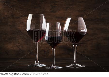 Selection Of Red Wine On Wine Tasting. Dry, Semi-dry, Sweet Red Wines In Special Wine Glasses On Old