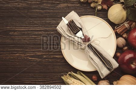 Thanksgiving Dinner Place Setting. Autumn Fruit, Pumpkins, Nuts, Fallen Leaves With Plate And Cutler