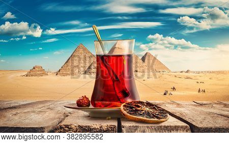 View Of The Pyramids In Egypt And Hibiscus Tea