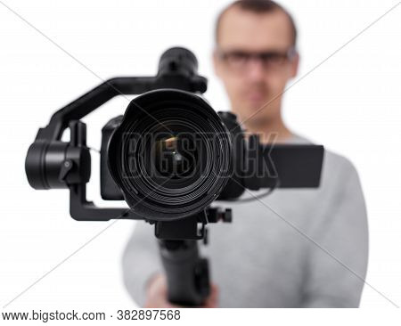 Close Up Of Dslr Camera On 3-axis Gimbal Stabilizer In Videographer Hands Isolated On White Backgrou