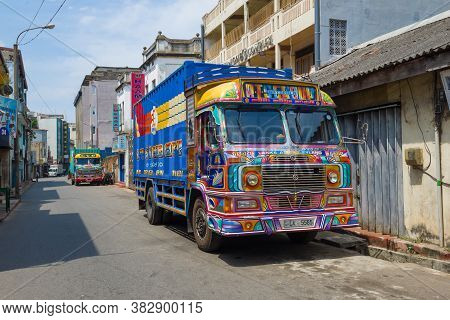 Colombo, Sri Lanka - February 23, 2020: Two Multi-colored Lanka Ashok Leyland Trucks On A City Stree