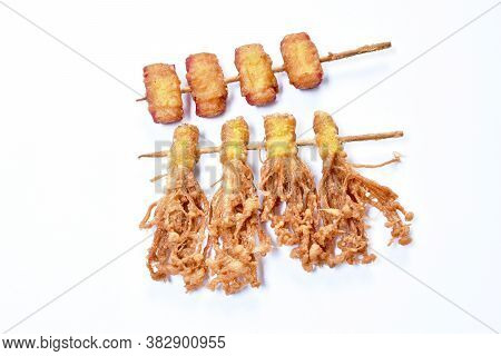 Deep Fried  Enokitakeor Needles Mushroom Wrapped Dumpling Flour And Bacon Stabbing In Wooden Stick I