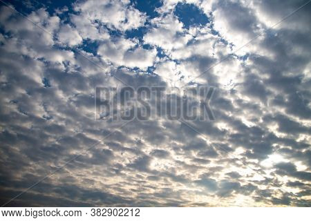 The Sky Is Covered With Small Clouds. The Sun Shines Through The Clouds. Sunny Day. Beautiful Backgr