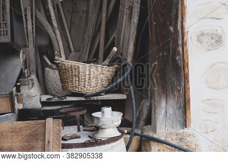 Korean Traditional Rattan Basket With Old Stone House Ware At The Storage Room