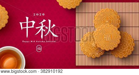 Mooncake On Bamboo Mat And Teacup, Chinese Translation Is Blessing And Mid Autumn. Top View Of Tea C