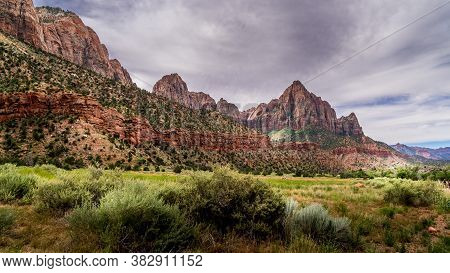 The Watchman And Bridge Mountain Viewed From The Pa\'rus Trail That Meanders Along And Over The Virg
