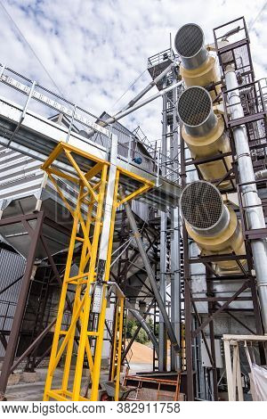 Modern Granary Elevator. Silver Silos On Agro-processing And Manufacturing Plant For Processing Dryi