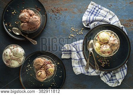 Variety Of Ice Cream Scoops With Chocolate, Stracciatella, Berry And Vanilla Flavors, Scooped In To