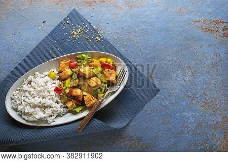 Eating Chinese Food With Rice, Salmon Fish And Vegetables