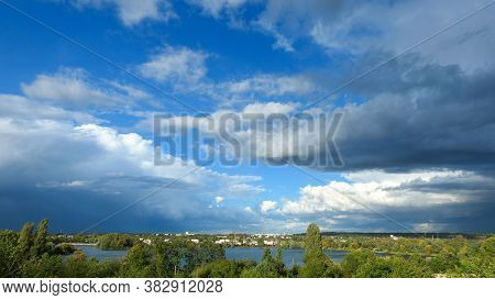 Blue Sky With Cumulonimbus Over The Water. Beautiful Landscape At The Countryside. Sunny Day With Vi