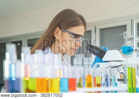 A Western Scientist Woman Working On Test Tube To Analysis And Develop Vaccine Of Covid-19 Virus In
