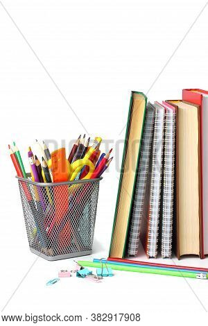 Back To School Or Education Concept. School Supplies And Textbooks On A White Background, Close-up.