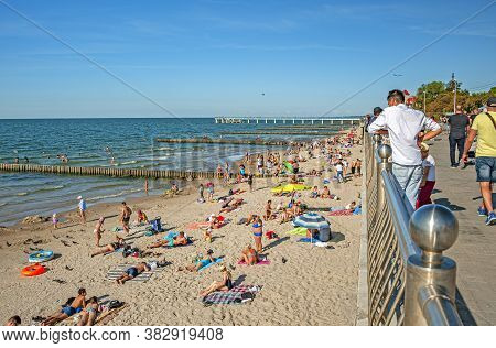Zelenogradsk, Russia - July 21, 2019: Beach Goers Enjoy Sun And Swimming At The Famous Baltic Resort