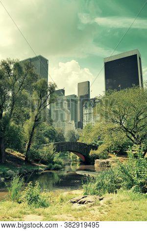 Central Park Spring with skyline in midtown Manhattan New York City