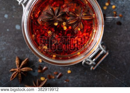 Chili Infused Oil In A Glass Jar Overhead Shot, Homemade Sauce