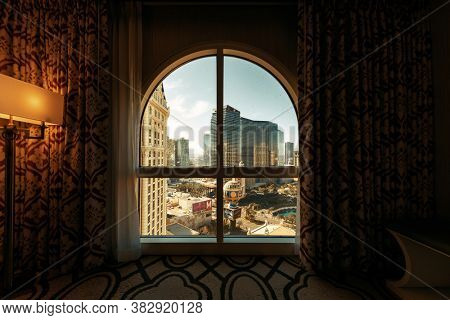 LAS VEGAS, USA - JAN 13, 2020: City urban view with modern casino hotel and resort architecture viewed from hotel room in Strip.