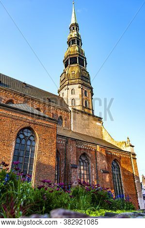 St. Peter Cathedral In The Old Town Of Riga (latvia). Riga Is Famous For Its Highly Diverse Architec