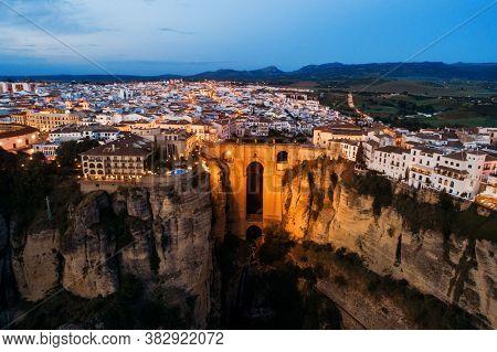 Puente Nuevo or New Bridge aerial view at night in Ronda Spain.