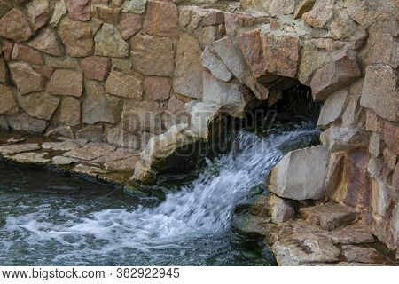 Mountain Spring With Pure Mineral Water. Ecologically Clean Water From The Holy Spring. Ecological T