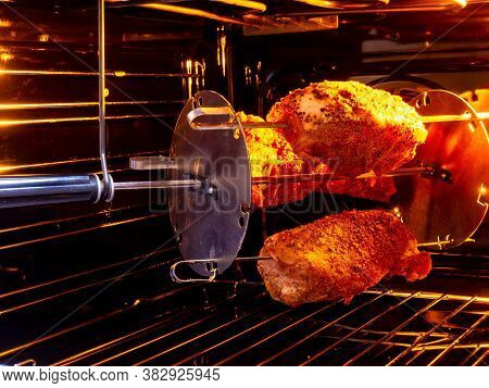 The Meat Is Grilled In An Electric Oven. Three Pieces Of Pork Are Processed With Spices. The Skewer