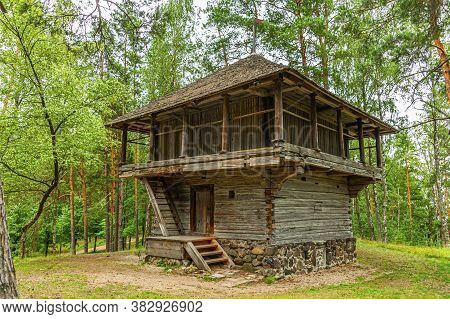 Old Latvian wooden house which represents architectural style  of the country regions.