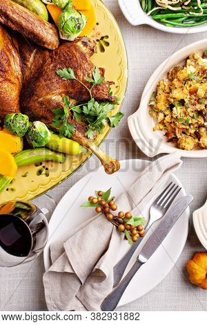Traditional Thanksgiving Table With Turkey, Gravy And Sides