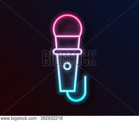 Glowing Neon Line Microphone Icon Isolated On Black Background. On Air Radio Mic Microphone. Speaker