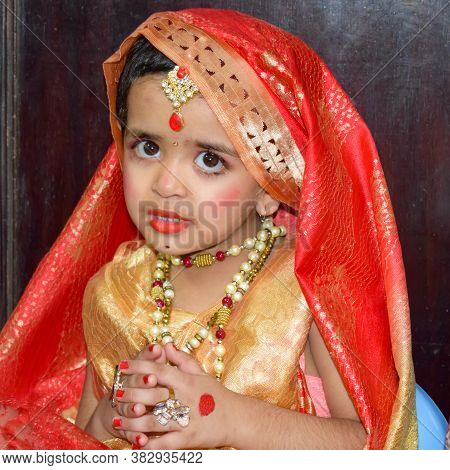 Cute Indian Kid Dressed Up As Little Lord Radha On The Occasion Of Radha Krishna Janmastami Festival