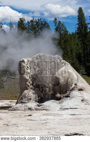 The Bacterial And Mineral Formation Of Giant Geyser With Steam Rising Against A Background Of Green