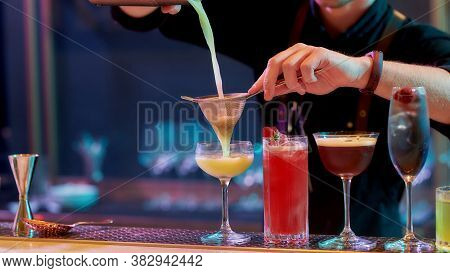 Fresh Up Your Night. Close Up Of Hands Of Male Bartender Pouring, Mixing Ingredients While Making Co