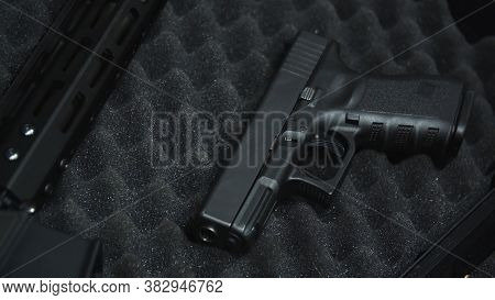 Handgun Pistol Laying In A Protective Case With Black Foam At The Shooting Range.