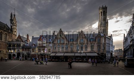 Brugge/belgium - Sept. 18 2018: Evening At The Historic Buildings Of The Town Hall And Basilica Of T