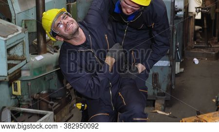 Factory Worker Injured By Accident While Using Machine In Factory In An Unsafe Condition . Maintenan
