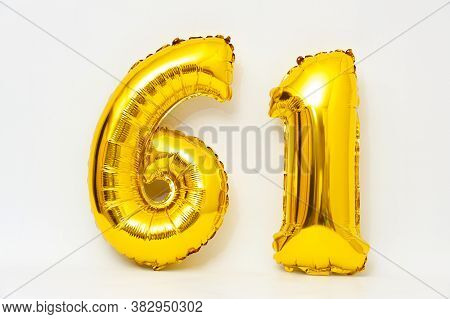 Inflatable Numeral 61 Sparkling Metallic Golden Color Isolated On White Background. Close-up. Horizo
