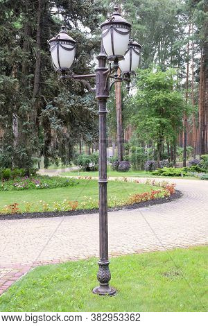 Antique Vintage Iron Lamppost 3 Lamps Standing In A Summer Park On An Alley