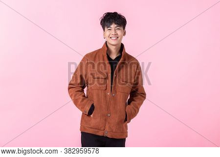 Fashion Portrait Of Confident Handsome Young Asian Man With Keeping Hands In Pockets Of Pocket The S