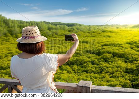 Asian Women Take A Photo Of Yellow Green Leaves All Around. Mangrove Forest Ecotourism Thung Prong T