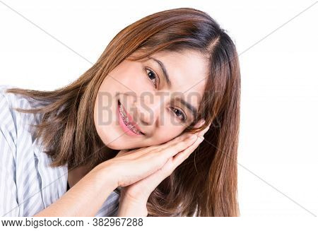 Woman Show Sleeping On Her Hand With White Background. Close Up Portrait