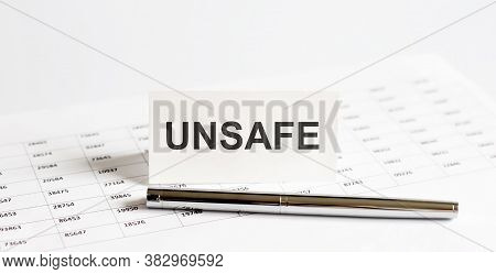 Text Unsafe On Stickers,pen On The Background Of Documents. Financial Bookkeeping, Accounting Concep