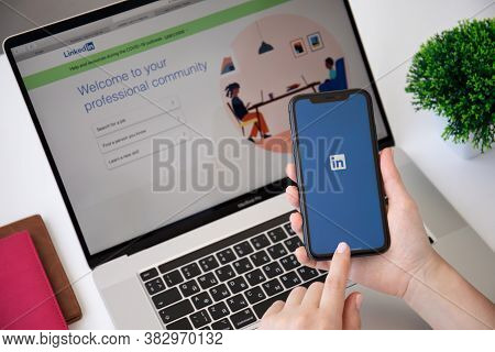 Alanya, Turkey - June 7, 2020: Woman Hand Holding Iphone 11 And Macbook Pro 16 With App Linkedin In