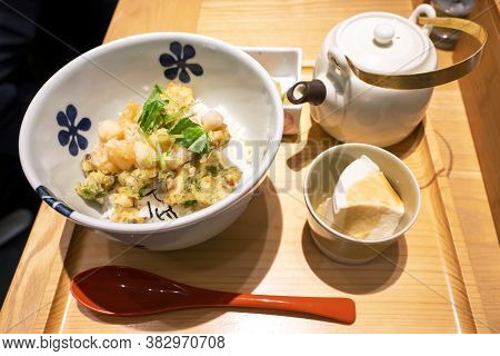 Selective Focus Of Chazuke / Japanese Porridge Soup With Shrimp Fried And Scallop Fried In The Resta