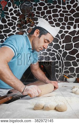 The Chef Prepares The Dough For Turkish Buns Tombik. Close-up. Making Buns For Fast Food. In The Bac